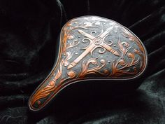 Hand-tooled leather saddle