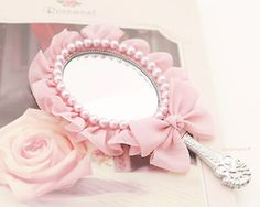 Decorated pink mirror