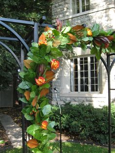 We design altar garlands for the ceremony. They are stunning and a great focal point for an outdoor wedding!