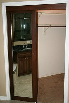 Check out the wood trimmed doors and full length mirrors on the Master Bath walk in closet.