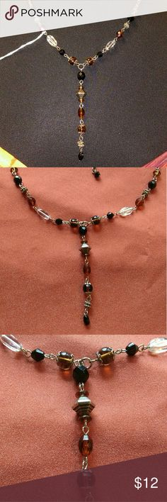 Pretty beaded necklace, silver with darker beading Silver toned chain with Amber, clear and brown beading.  Chain is about 20 inches but would wear better closer to choker style so the beading is centered.  Very attractive. unknown Jewelry Necklaces