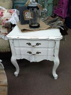 $79 - This French provincial end table has been painted white and distressed. That has two single drawers and original metal hardware. The table measures 22 inches across the front , 27 inches deep and stands 22 inches tall. It can be seen in booth D 8 at Main Street Antique Mall 7260 East Main St ( E of Power Rd ) Mesa 85207  480 9241122open 7 days 10 till 530 Cash or charge accepted
