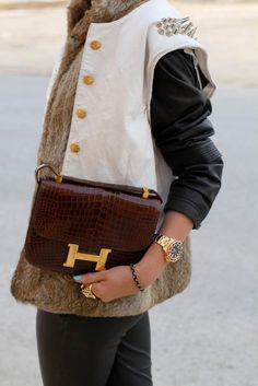 Loving all the textured layers to this look - from the croc Hermes to the fur and stud hardware. <3