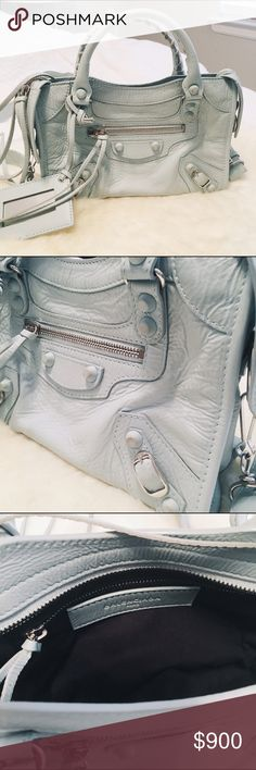 Balenciaga Mini City Baby Blue Gently pre loved Balenciaga Classic Mini City Baby Blue. It was the holiday edition featuring the rubber covered tone on tone studs. Authentic, comes with dust bag and the piece of replacement leather, leather framed mirror and removable adjustable leather strap. Overall in excellent pre loved condition. Balenciaga Bags Crossbody Bags