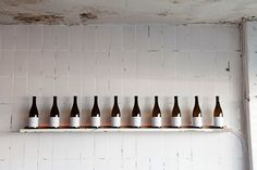 bottles on wall | subway tile