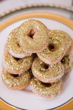 Maybe we should start every day with a glittered doughnut!  See more here: http://www.StyleMePretty.com/canada-weddings/2014/05/15/gold-apricot-inspiration-shoot/ Photography: GeminiPhotographyOntario - Doughnuts: SweetCelebrationsweddingcakes.com