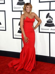 Tamar Braxton was radiant in a red strapless Michael Costello gown. Serve! | Fashion Bomb daily #GRAMMYs 2014