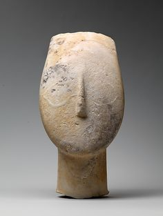 The traces of eyes, in extremely low relief, indicate that they originally were rendered with pigment. The painted marble weathered less rapidly than the adjoining unpainted surfaces.