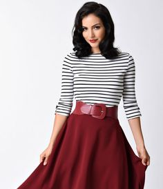 Is there anything like it, darlings? A luxuriously soft retro minded separate by Banned in a sleek black and white stripe knit, stretchy and fabulously feminine! A boat neckline meets three-quarter sleeves, each notched with a dainty bow. The form fitted