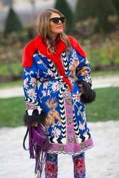 Anna Dello Russo in a gorgeous Tom Ford Fall 2013 coat with matching boots and a Gucci fringe handbag.