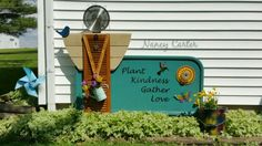 I painted my favorite garden saying on an old metal headboard,  made a flower from a planter plate with some crystal lamp parts and attached my shutter garden angel that I made.  Nancy Carter