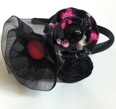 Girl's Headband with Black, Red, and Pink Ribbon Flowers and a Black Satin Ribbon Rosette. $12.00, via Etsy.