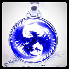 """Blue Phoenix Cabochon Pendant Necklace He's returned! Literally a restocked (not returned) item!   This one is made better. Which is why it's a dollar more than previous. (See photo of the back of the pendant)  Perfect for a Phoenix Fantasy lover. """"Rise up from the ashes''  Also, this necklace is just plain beautiful! Free gift of equal or lesser value  Jewelry Necklaces"""