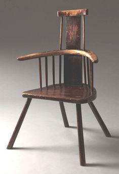 Welsh comb back stick chair –   Cadair cefn ffyn -  With an unusual single plank back rest and arms made from a single piece of timber.  Ash and oak with traces of original paint and old varnish.  Cardiganshire c1800,  25″ wide x 38″ high x 15½″ deep