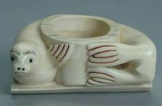 An early Eskimo carved walrus ivory bowl in the form of a seal from Nunivak Island c.1900. This piece comes from the Koslowsky Collection out of Alabama and is in excellent condition.
