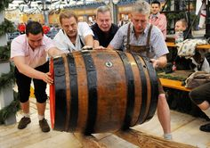 Google Image Result for http://allmyfriendstravel.com/wp-content/uploads/2012/10/Oktoberfest-in-Munich-Workers-move-the-first-beer-barrel-for-the-opening-day-of-the-176th-Oktoberfest-in-Munich-Germany-2009-photo-AP-Uwe-Lein.jpg