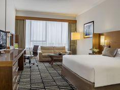 Premium room at Jumeira Rotana with breathtaking views of Burj Khalifa from your window of your spacious 40 sqm room, offering either king or twin beds. All premium rooms are accessorised with a flat screen TV, International channels, wireless Internet and DVD player.