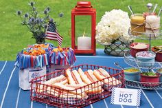 """Celebrate Magazine: Hotdog Bar, """"pom pom"""" chip sacks, and tiered condiments. like idea of condiments on tier stand 4th Of July Party, Fourth Of July, Hamburger Bar, American Buffet, Celebrate Magazine, Party Food Buffet, Hot Dog Bar, Grillin And Chillin, Delicious Burgers"""