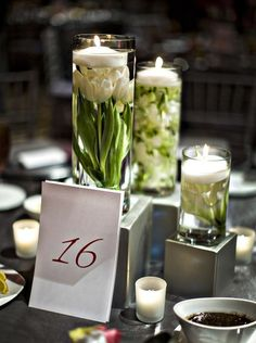 Modern + intimate with the candlelight. Green stems tie in perfectly with the green accent color.. kw