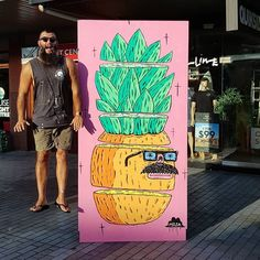 Yesterday was sweet down at the mall painting with friends new and old for Beach to the Burbs music fest.  Cheers to the organisers everyone who came and had a paint with me and @taubmans for the paint.  This is a photo of me and Chappy the Chopped Pineapple.  The story of Chappy the Chopped Pineapple  Once there was a pineapple called Chappy and he was a life guard at the beach. One day he went swimming in the water to rescue a penguin called Tim who was struggling in the rip but instead a… Joel Moore, Life Guard, Pineapple Express, The 'burbs, Music Fest, Planet Of The Apes, Organisers, Mural Painting, Freelance Illustrator