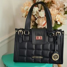 """soldVersace Italia purse Absolutely beautiful black authentic Versace Italia bag. It has a leather quilted pattern on front and back. Gold hardware. 9"""" x 13"""" x 6"""". Has two small pockets on one side and then a large zip pocket on the other. I've only used the bag a couple times..hate to part with it but I already have too many black purses.  10% off 2 items or more ➡ bundle & save.  ✔dont want to bundle ➡ make a REASONABLE offer. ✖items priced $5 or less are firm, unless bundled. no trades…"""