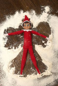 Elf does snow angel....kitschy coo