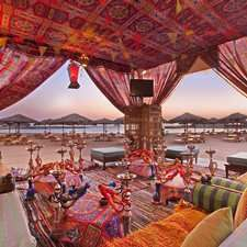 Shisha Corner || Relax on low Arabic seats and rugs and experience a traditional shisha water pipe at this beachfront Hurghada bar. Sample Egyptian teas, coffees and local karkade hibiscus juice, as you gaze out over views of the Red Sea and the private beach at the Hilton Hurghada Plaza hotel.