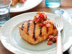Bobby's Grilled Salmon with Sherry Vinegar-Honey Glaze and Spicy Tomato Relish : Bobby balances the smoky char of the grill with the sweetness of his honey-ancho chile glaze atop his light salmon. For a fresh finish, he serves the fish with a no-cook relish featuring juicy tomatoes and a classic vinaigrette. via Food Network