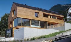 Category: Houses  Keywords: Architecture, wooden facade, Liechtenstein, modern family house, family house on a slope, gable roof, the slope