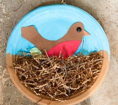 Cute for spring!  Paint the paper plate, glue on nest materials, (paper shreds, string, yarn bits, tiny twigs, etc.) then cut colored paper for the bird, fabric or patterned scrapbook paper for eggs, finish with a button for the eye.