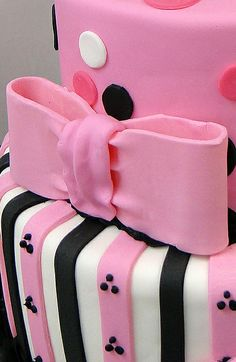 Eiffel Tower Birthday Cake ~ Decorated in pink, black and white Polka Dots and Stripes  wrapped in a big Pink Bow.