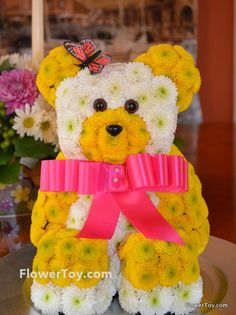 This Bear arrangement is made of fresh flowers and looks like your favorite toy.