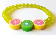 Pulsera Niña Cuentas Cristal Amarillo con Frutas de madera Elastica Nuevo unica