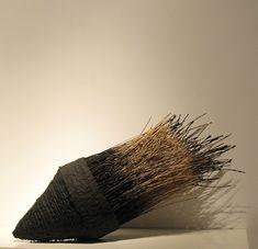 Eva Ennist, Black Lotus #3, 2009, bamboo, reed, handmade paper, concrete, wood