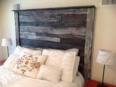 This Rustic Wood Headboard has a dark reclaimed wood finish. Each headboard is hand crafted giving each item a unique finish. This headboard is perfect for a vintage, rustic style bedroom. The display item is fastened to the wall directly allowing the bed to free float and help prevent the headboard from rocking. We will provide hardware and directions for fastening it to the wall. We also will offer installation at an additional charge. Feel free to contact us for any further questions.