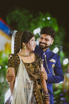 """Wedding Jingles """"Sneha weds Alok"""" Candid Couple Shot - Bride in a Black and Gold Sequinned Lehenga and Groom in a Blue Suit. WeddingNet couple kerala Photo from Wedding Jingles """"Sneha weds Alok"""" album Indian Bride Poses, Indian Wedding Poses, Indian Bridal Photos, Indian Wedding Couple Photography, Couple Photography Poses, Photographer Wedding, Engagement Photography, Couple Photoshoot Poses, Couple Posing"""