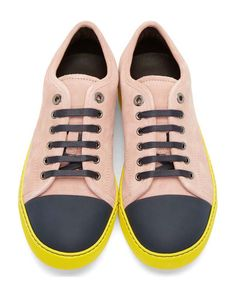 Grey Navy Color blocked Suede Sneakers by Lanvin. Low-top suede sneakers in dusty pink. Round toe capped in grey-navy buffed leather. Lace-up closure in dark grey-navy with gunmetal-tone eyelets. Bright yellow foxing and sole with dark grey welt stitching. Lined in black leather. http://www.zocko.com/z/JKKh8