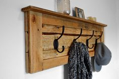 Entryway coat hooks made from reclaimed pallet wood. Available from bydadanddaughter.etsy.com
