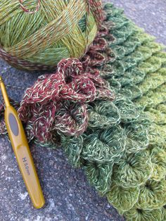"Crocodile stitch - so pretty -- this link is just for the photo.  One of the comments on that page recommends the following link for the ""how to"":  http://www.ravelry.com/patterns/library/crocodile-stitch"
