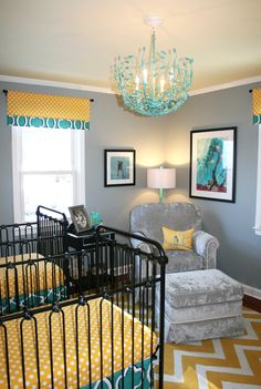 Twins nursery for a BOY and  GIRL! Sherri Blum, celebrity nursery designer and owner of Jack and Jill Interiors has created this whimsical nursery featuring hand-printed dachshund wall paper, stunning black iron cribs and custom designed bedding in teal and yellow. While she splurged on the branch/nest chandelier, Sherri was able to save the couple money by purchasing gold tree branch lamps from discount stores and personally spray painting the to match the chandelier. <3