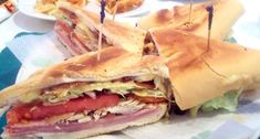 Miami Sandwich: Ham, turkey, melted Swiss cheese, bacon, tomato, lettuce, pickles and Cuban bread