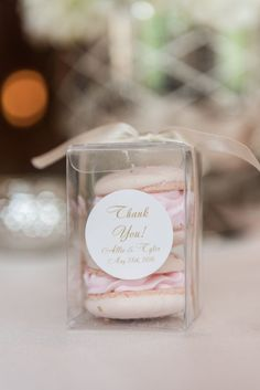 These elegant macaron wedding favors are one of our WeddingWire editors' top picks. WeddingWire has tons of wedding favor recommendations at all price points. Click for more wedding favor ideas. Planning your wedding has never been so easy (or fun!)! WeddingWire has tons of wedding ideas, advice, wedding themes, inspiration, wedding photos and more. {Tara Draper Photography}