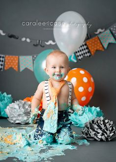 Idaho Falls, ID baby and child birthday photographer. Caralee Case Photography. cake smash boys orange teal gray balloons #cakesmash #firstbirthday #pictures #oneyear