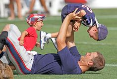 Tom Brady plays with sons, John and Benjamin, at the New England Patriots training camp at Gillette Stadium in Foxborough, Massachusetts.