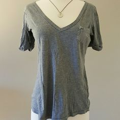 abercrombie & fitch // grey shirt selling for a friend. cozy v neck, 3/4 sleeve. button up sleeves. heather grey, on pocket on bust. Abercrombie & Fitch Tops Tees - Long Sleeve