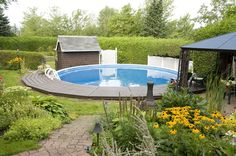 Above ground pool, retaining wall. Super natural looking garden. What a comfortable back yard. Love it!