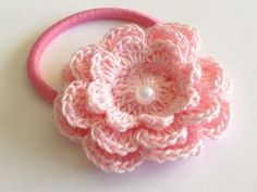 Crochet Flower with Ponytail - Pastel Pink Flower with Pearl Style Center by LMCrochet on Zibbet
