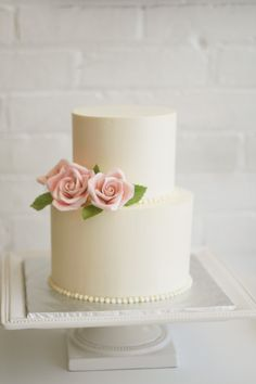 Buttercream cake with pink sugar roses