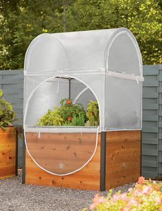 """Cedar, aluminum, marine-grade plywood, powder-coated steel, nylon connectors, reinforced PVC fabric  4' L x 4' W x 7' H overall  Elevated Raised Bed is 4' W x 4' L x 29"""" H  Planting depth is 10""""  Holds 329 quarts of soil  Assembly required  Gardener's Supply Exclusive"""