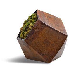 designer:  Jinggoy Buensuceso retailer:  Hive Modern Boulder planter in oxidized metal by Jinggoy Buensuceso for Hive, from $95 designbyhive.com